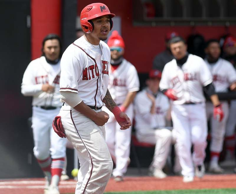 Mitchell College´s Lelo Martinez (33) reacts to scoring a run during the NECC baseball championship game against Elms College on Sunday, May 9, 2021 at the school in New London.  Mitchell won the game 15-2 and earns a bid to NCAA Division III tournament.   (Sarah Gordon/The Day)