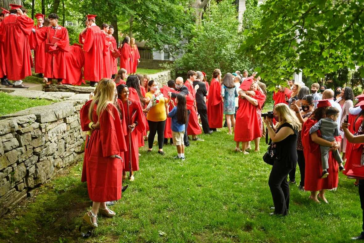 Members of the St. Bernard School class of 2021 take photos in Monsignor King Memorial Park following commencement exercises Wednesday, June 2, 2021 at the Cathedral of St. Patrick in Norwich.  (Sean D. Elliot/The Day)