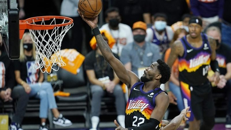Phoenix Suns center Deandre Ayton scores against the Los Angeles Clippers during the first half of Game 1 of the NBA basketball Western Conference finals Sunday, June 20, 2021, in Phoenix. (AP Photo/Ross D. Franklin)