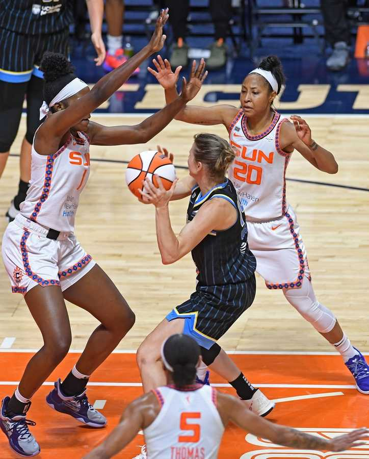 Connecticut Sun defenders Beatrice Mompremier, left, and Briann January, and Jasmine Thomas triple team Chicago Sky guard Allie Quigley in WNBA action Sunday, June 27, 2021 at Mohegan Sun Arena in Uncasville, Conn.  (Sean D. Elliot/The Day)