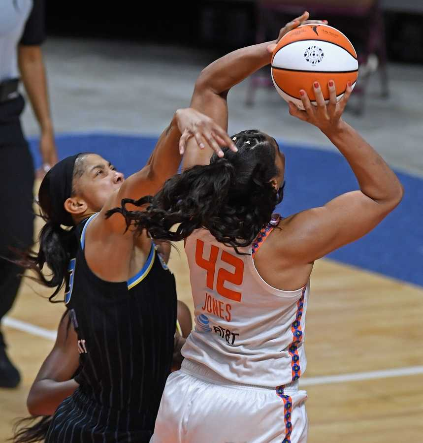 Chicago Sky forward Candace Parker fouls Connecticut Sun center Brionna Jones in the second half of WNBA action Sunday, June 27, 2021 at Mohegan Sun Arena in Uncasville, Conn. The Sun rolled to the 74-58 win. (Sean D. Elliot/The Day)