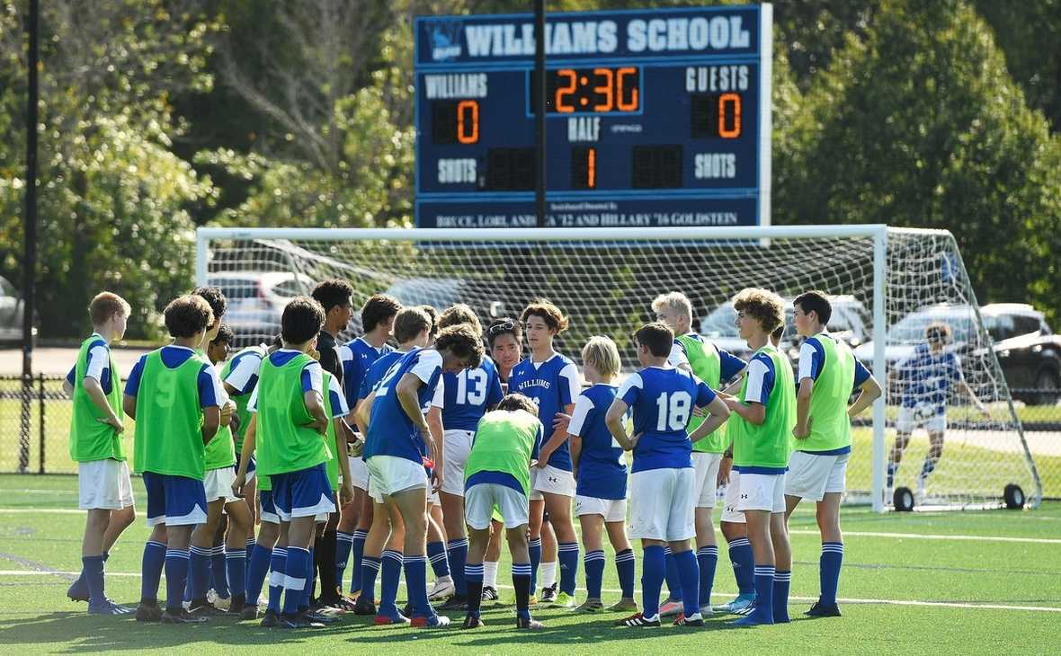 Williams School head coach Jason Lu huddles his team before they face Watkinson in boys prep school soccer action Monday, September 13, 2021 in Waterford. The host Blues raced out the to 4-0 halftime lead and rolled to the 7-4 win over the Rams.  (Sean D. Elliot/The Day)