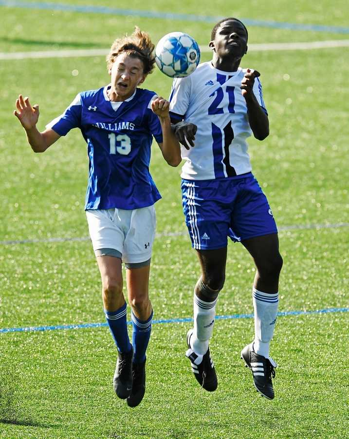 Williams School midfielder Ben Xenelis (13) and Watkinson defender Willam Ellis (21) go up for the ball in boys prep school soccer action Monday, September 13, 2021 in Waterford. The host Blues raced out the to 4-0 halftime lead and rolled to the 7-4 win over the Rams.  (Sean D. Elliot/The Day)