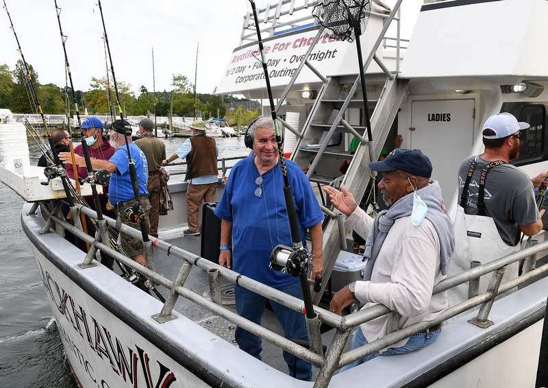 Navy veteran Wayne Porter, left, and Army veteran Ken Hardy, both residents of Rocky Hill Veterans Home, talk Tuesday, Sept. 14, 2021, after boarding the Blackhawk in Niantic for a 'Hook Up With A Vet' fishing trip. The annual event is a collaboration between boat captain Greg Dubrule, the Northeast Saltwater Fishing Club and other local sponsors.  (Sarah Gordon/The Day)