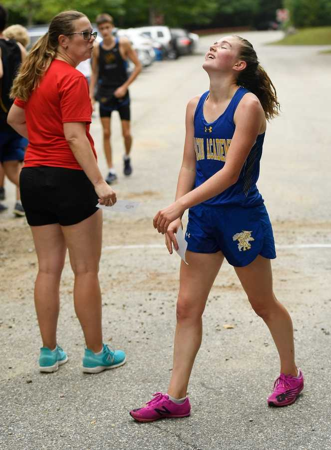 Bacon Academy's Jordan Malloy reacts after finishing first during a quad meet with NFA, Tourtelotte, Ledyard, and Bacon Academy Tuesday, September 14, 2021 at Mohegan Park in Norwich.  (Sean D. Elliot/The Day)