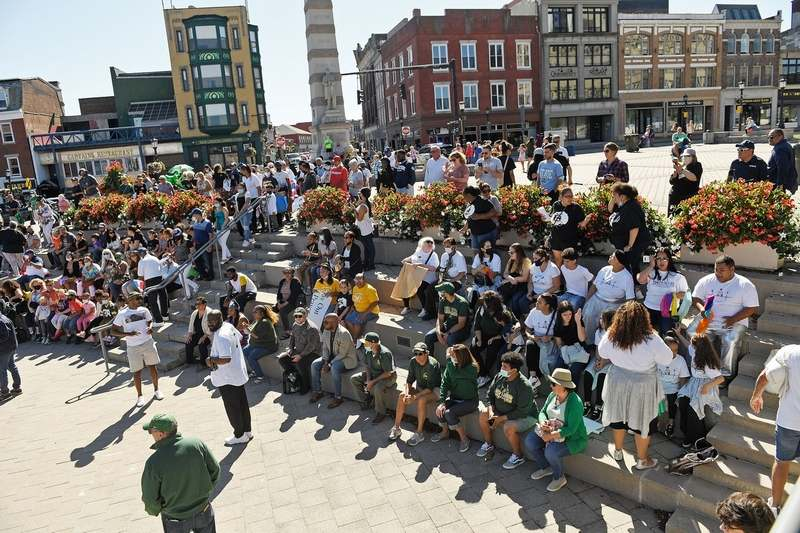 Participants in the We Are New London parade gather for a recognition ceremony at the Whale Tail on Parade Plaza Sunday, September 26, 2021. (Sean D. Elliot/The Day)