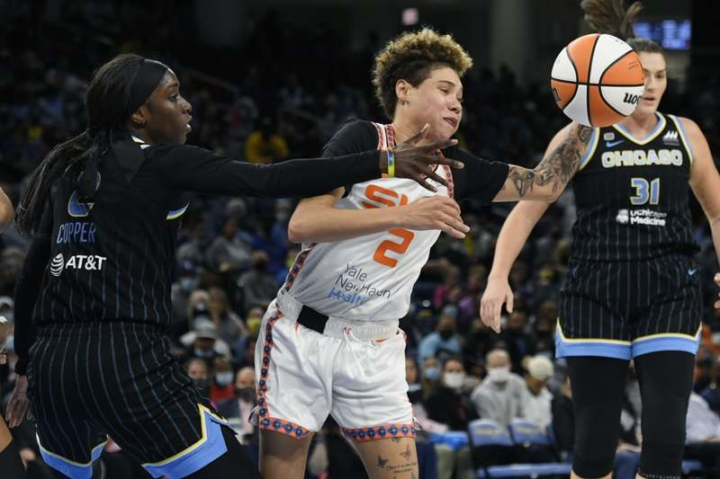 Connecticut Sun's Natisha Hiedeman, center, is defended by Chicago Sky's Kahleah Copper, left, during the second half of Game 4 of a WNBA basketball playoff semifinal, Wednesday, Oct. 6, 2021, in Chicago. Chicago won 79-69. (AP Photo/Paul Beaty)